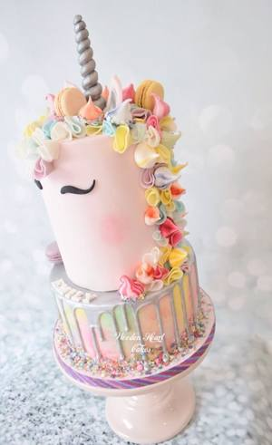 Blush colour Unicorn cake with watercoloured base