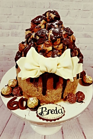 Chocolate ferrero drip and profiterole cake