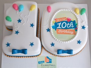 Corporate cake branded 10 years ballons