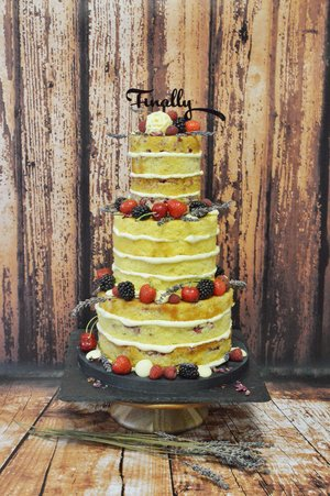Naked cake with berries and lavender.