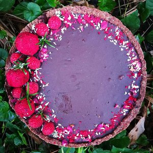 Gluten free & vegan chocolate ganache cake with fresh raspberries
