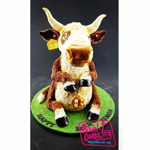 Carved cow cake
