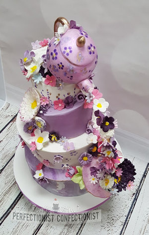 Topsy turvy  wedding cake  cake  wedding  purple  flowers  teapot  cup and saucer  chocoalte  banana  carrot cake  baileys cake  roganstown hotel  dublin %286%29
