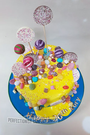 Drip cake  drip birthday cake  sweets  candy  chocolate biscuit cake  yellow  blue  novelty  30th  birthday  cake  dublin  swords  malahide %284%29