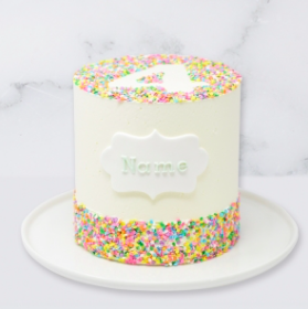 "The ""Sprinkles"" Children's Birthday Cake is a buttercream iced cake. The single tier is 6″ deep and 2 tier options are 10″ deep. The icing colour, number and name can be customised."