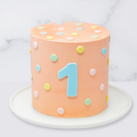 "The ""Pastel Dots"" Children's Birthday Cake is a buttercream iced cake. The single tier is 6″ deep and 2 tier option is 10″ deep. The icing colour and number can be customised, with the option of adding a name plaque on top."