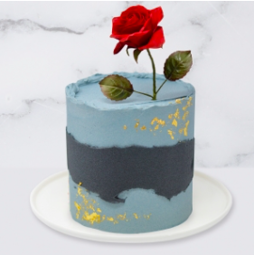 The Abstract, Rose & Gold Leaf Cake is a buttercream iced cake. The single tier is 6″ deep and 2 tier options are 10″ deep. You can choose to have either a handmade sugar rose,  which is edible, or a fresh rose.  A name plaque can be added to the front of the cake.