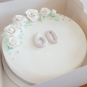 Elegant White Fondant Cake with Sugar Roses