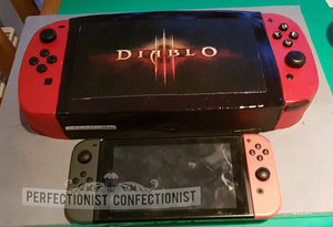 Nintendo switch cake  nintendo switch  cake  celebration  novelty  diable 3  diablo iii  demonware  dublin  swords  kinsealy  malahide  corporate cake %282%29