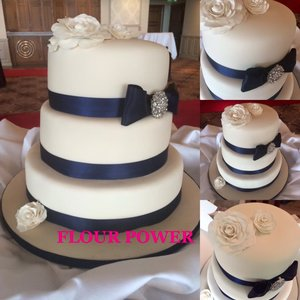 Three tier navy white wedding cake
