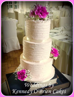 Soft blush pink buttercream and fresh flowers wedding cake