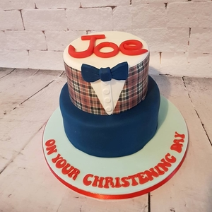 An amazing two tier christening cake made with tartan print to match the little boys outfit