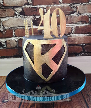 Superman  k  logo  birthday cake  40th  malahide  kinsealy  dublin  black  gold  man  celebration  novelty  chocolate biscuit cake  %281%29