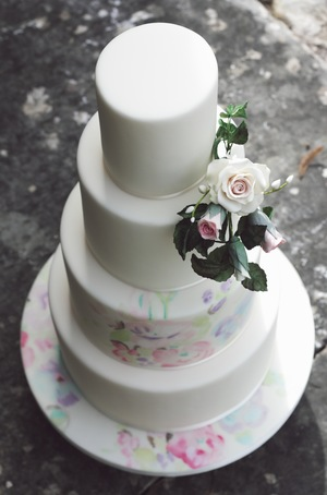 Hand Painted Untamed Love Wedding Cake. Photograph by Portraits By Patrick