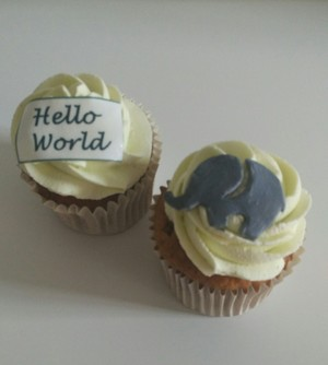 Christening cupcakes to match 'Hello World' baby shower cake